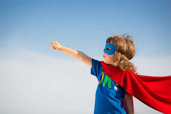 This image has an empty alt attribute; its file name is boy-with-cape-and-mask.jpg
